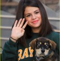 Selena Gomez holds her new puppy Bailer.